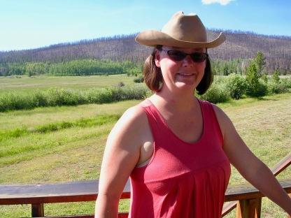 wearing cowboy hat